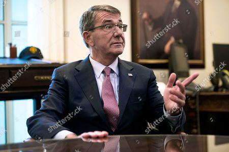 Secretary of Defense Ash Carter is interviewed in his Pentagon office, in Washington. Carter said Wednesday he had opposed commuting the prison sentence of convicted leaker Chelsea Manning, who was convicted in 2013 of espionage and other crimes for leaking classified information while deployed in Iraq