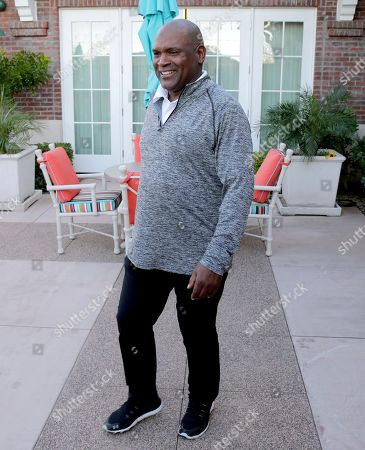 Tim Raines leaves a t.v. interview, in Goodyear, Ariz., shortly after being elected to baseball's Hall of Fame. Raines, fifth in career stolen bases, was a seven-time All-Star and the 1986 NL batting champion. He spent 13 of 23 big league seasons with the Montreal Expos and joins Andre Dawson and Gary Carter as the only players to enter the Hall representing the Expos. Raines was elected with 86 percent of the vote