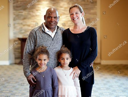 Tim Raines poses for a photograph with his family--wife, Shannon, and daughters, Ava, 6, left, and Amelie, 6, in Goodyear, Ariz. after a television interview shortly after being elected to baseball's Hall of Fame. Raines, fifth in career stolen bases, was a seven-time All-Star and the 1986 NL batting champion. He spent 13 of 23 big league seasons with the Montreal Expos and joins Andre Dawson and Gary Carter as the only players to enter the Hall representing the Expos. Raines was elected with 86 percent of the vote