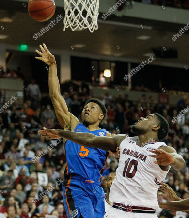 Florida guard KeVaughn Allen (5) floats a layup over South Carolina guard Duane Notice (10) in the NCAA Basketball matchup at Colonial Life Arena in Columbia, SC
