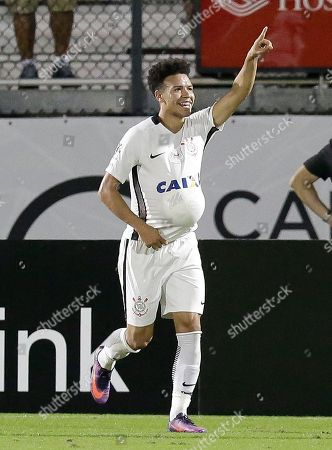 Corinthians forward Marquinhos celebrates as he points to fans and stuffs a soccer ball under his jersey after scoring a goal against Vasco Da Gama during the second half of a Florida Cup soccer match, in Orlando, Fla. Corinthians won 4-1