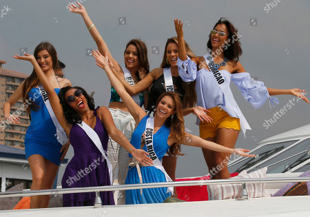 Stock Image of Cherell Williamson, Carolina Duran, Flavia Brito, Rebecca Rath, Hildur Maria, Chanelle de Lau Miss Universe contestants pose from the deck of the yacht Happy Life prior to cruising to a beach resort in Batangas province south of Manila at the Philippine Navy headquarters in Manila, Philippines. Eighty-six candidates from around the world are vying for the title to succeed Pia Wurtzbach from the Philippines. The competition takes place on Jan. 30. From left front row, Cherell Williamson of Bahamas and Carolina Duran of Costa Rica. Back row from left, Flavia Brito of Portugal, Rebecca Rath of Beliz, Hildur Maria of Iceland and Chanelle de Lau of Curacao