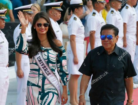 Miss Universe 2015 Pia Wurtzbach, escorted by Governor Luis Chavit Singson, waves as she walks to the yacht Happy Life to join contestants in a cruise to a beach resort in Batangas province, south of Manila, at the Philippine Navy headquarters in Manila, Philippines. Eighty-six candidates from around the world are vying for the title to succeed Pia Wurtzbach from the Philippines. The competition takes place on Jan. 30
