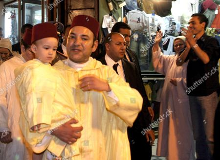 Moroccan King Mohammed Vl Meets Medina Residents As He Holds Crown Prince Moulay El Hassan During His Visit at the Moulay Driss Al Azhar Mausoleum During Circumcision Festivities On 13 April 2005 in Fez Morocco