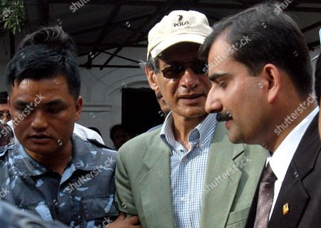 French Charles Sobhraj (c) 60 Alleged Killer of Dozens of Tourists Across Asia On His Way out From the District Court at a Police Vehicle After His Final Verdict in Kathmandu Nepal On Thursday 12 August 2004 Kathmandu District Court On Thursday Gave Sobhraj a Life Sentence in Prison