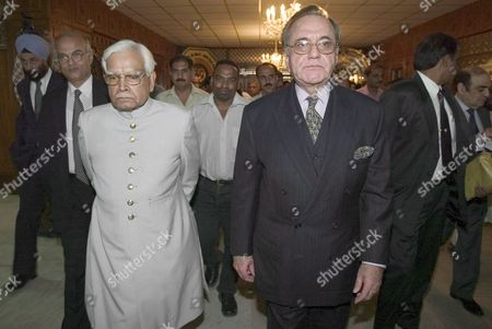 Indian Foreign Minister Natwar Singh (l) and Pakistani Foreign Minister Khursheed Mahmood Kasuri (r) Leave the Pakistan Foreign Ministry After Attending a Joint Press Conference On Peace Progress in Islamabad On Tuesday 04 October 2005