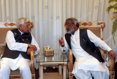 Indian Foreign Minister Natwar Singh (l) Talks with Pakistan's Sindh Provincial Chief Minister Dr Arbab Ghulam Rahim (r) On His Visit at the Chief Minister House in Karachi On Tuesday 04 October 2005