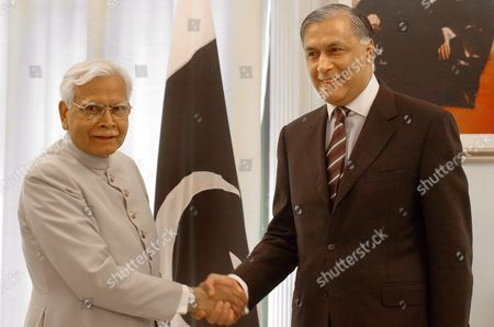 Indian External Affairs Minister Natwar Singh (l) Shakes Hands with Pakistan Prime Minister Shaukat Aziz On Tuesday 04 October 2005 in Islamabad Pakistan and India On Tuesday Discussed the Siachen Glacier Issue and Framework For Progress For Peace