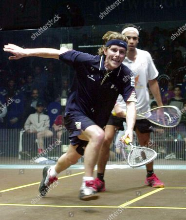 Stock Picture of Peter Nicol of England in Front Tries to Pick a Drop Shot From Egyptian Hisham Ashour in Background During the First Round Match of the World Open Squash Tournament in Lahore On Sunday 14 December 2003 Nicol Beat Ashour and Advanced to the Second Round