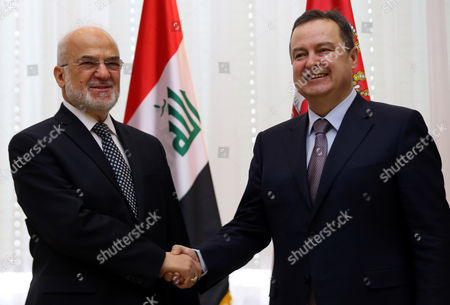 Serbian Foreign Minister Ivica Dacic (R) greets his Iraqi counterpart Ibrahim Al-Jafari (L) before their meeting in Belgrade, Serbia, 19 January 2017. Al-Jafari is on a one day visit to Serbia.