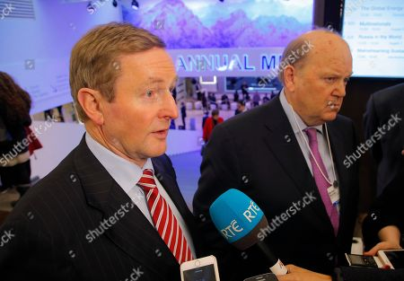 Irish Prime Minister Enda Kenny, left, and Finance Minister Michael Noonan answer journalists questions on the third day of the annual meeting of the World Economic Forum in Davos, Switzerland