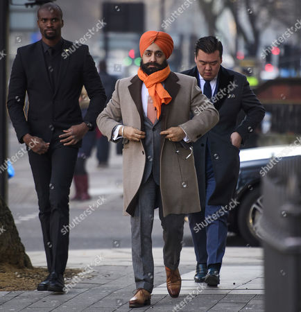 Stock Photo of Conservative Party donor and Businessman Peter Singh Virdee (centre), flanked by security guards as he arrives at Westminster Magistrates Court in London where he faces extradition to Germany