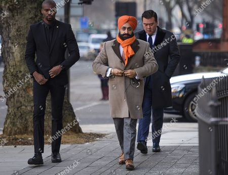 Conservative Party donor and Businessman Peter Singh Virdee (centre), flanked by security guards as he arrives at Westminster Magistrates Court in London where he faces extradition to Germany