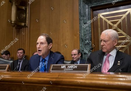 Orrin Hatch, Ron Wyden Senate Finance Committee Chairman Sen. Orrin Hatch, R-Utah listens at right as the committee's ranking member, Sen. Ron Wyden, D-Ore. challenges Treasury Secretary-designate Stephen Mnuchin during his confirmation before the committee, on Capitol Hill in Washington