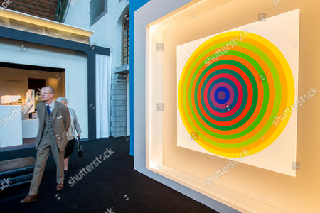 People walk next an artwork entitled 'Surface couleur' by Argentinian artist Julio Le Parc during the BRAFA Art Fair in Brussels, Belgium, 19 January 2017. The BRAFA features 132 antique dealers and gallerists from 16 different countries and runs from 21 to 29 January.