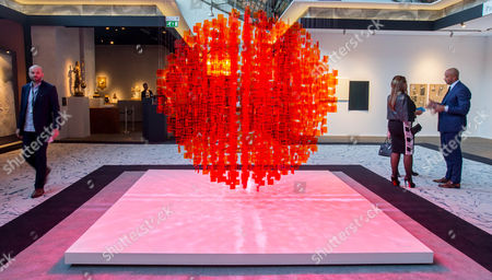 People walk by an artwork entitled 'Continuel Mobile' by Argentinian artist Julio Le Parc during the BRAFA Art Fair in Brussels, Belgium, 19 January 2017. The BRAFA features 132 antique dealers and gallerists from 16 different countries and runs from 21 to 29 January.
