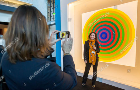 A woman has her picture taken in front of an artwork entitled 'Surface couleur' by Argentinian artist Julio Le Parc during the BRAFA Art Fair in Brussels, Belgium, 19 January 2017. The BRAFA features 132 antique dealers and gallerists from 16 different countries and runs from 21 to 29 January.