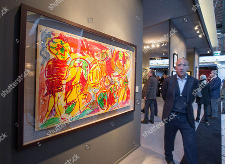 A man walks by a painting by Belgian artist Pierre Alechinsky titled 'L'Ordinaire du Perou' during the BRAFA Art Fair in Brussels, Belgium, 19 January 2017. The BRAFA features 132 antique dealers and gallerists from 16 different countries and runs from 21 to 29 January.