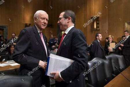 Stephen Mnuchin, Orrin Hatch Treasury Secretary-designate Stephen Mnuchin, right, is welcomed on Capitol Hill in Washington, by Senate Finance Committee Chairman Sen. Orrin Hatch, R-Utah as he arrives for his confirmation hearing before the committee