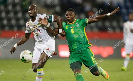 Senegal's Moussa Sow, left, is challenged by Zimbabwe's Elisha Muroiwa, left, during the African Cup of Nations Group B soccer match between Senegal and Zimbabwe at Stade de Franceville Stadium, in Franceville, Gabon