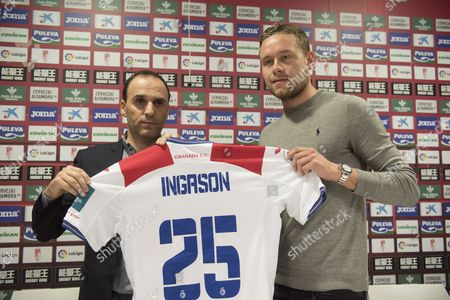 Granada sport director, Javier Torralbo (L) and Icelandic defender Sverrir Ingi Ingason (R) attend to the press conference during his presentation as a new player of Granada CF, at the sport facilities of the team, in Granada, Andalusia, southest Spain, 19 January 2017. Ingason signs with Granada CF until 2020.