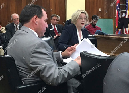 Stock Picture of Arkansas state Rep. Andy Mayberry, left, takes notes as Victoria Leigh testifies against an abortion-restriction bill on behalf of the American Civil Liberties Union at the Arkansas State Capitol, in Little Rock, Ark. The House Public Health, Welfare and Labor Committee endorsed Mayberry's proposal, which would ban dilation and evacuation, which is a common abortion procedure in the second trimester