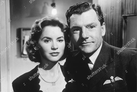 """Stock Image of MURIEL PAVLOW AND KENNETH MORE IN """" REACH FOR THE SKY """""""