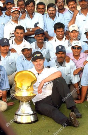 Qatar Masters Champion Joakim Haeggman of Sweden Poses with the Pearl Trophy and Doha Golf Course Officials at the Doha Golf Club in Doha Qatar Sunday 14 March 2004 Haeggman Scored an Aggregate of 16-under-par 272 For a One Stroke Victory
