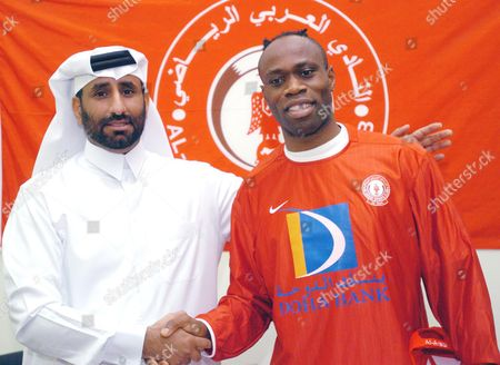 Former Nigerian World Cup Soccer Star Taribo West (r) Signed a One Year Contract with Qatar's Al Arabi Sports Club Al Arabi Team Manager Khalifa Al Nassrer (l) Cogragulates West After the Signing Ceremoney Held at Doha On 5 August 2004