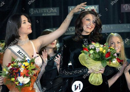 Miss Universe 2003 Amelia Vega (l) From Dominican Republic Adjusts the Crown Which Decorates the Head of Ksenia Kustova From Novosibirsk During the Show Which is to Select a Representative From Russia For the Miss Universe 2004 Contest Moscow Late Friday 16 April 2004 Ksenia Kustova Won the Competition and Will Take Part in Miss Universe 2004 Contest