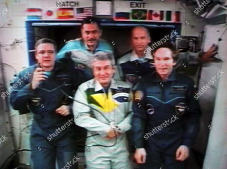 A Picture Taken From the Screen in the Korolyov Space Control Center Outside Moscow Shows Brazilian Astronaut Marcos Pontes (c) Surrounded by (l-r) Iss Commander Bill Mcarthur of the U S Russian Cosmonaut Pavel Vinogradov Jeffrey Williams of the U S and Russian Flight Engineer Valery Tokarev During the News Conference From the International Space Station 03 April 2006