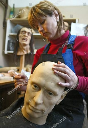 Stock Photo of Make-up Artist Anna Volkova Works On a Wax Head of Russian President Vladimir Putin in a Wax Figures Studio in Lomonosov Outside St Petersburg 07 October 2004 the Studio Produce and Repair Wax Figures For Various Exhibitions