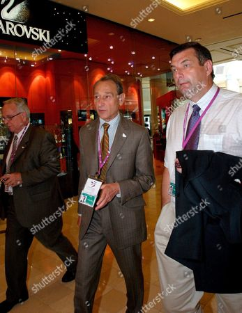 Paris Mayor Bertrand Delanoe C Walks with France's Sport Minister Jean-francois Lamour and Theinternational Olympic Committee Member Henri Serandour (l) From France in Singapore Monday 04 July 2005 Paris Bid to Host the 2012 Summer Olympic Games Puts It Up Against London New York Madrid Moscow the Ioc Will Formally Hear the Contending Citites Bids and Announce the Winner After Voting Wednesday in Singapore