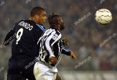 Real Madrid Striker Ronaldo (l) and Taribo West of Partizan Belgrade Jump For the Ball During Their Uefa Champions League First Round 2nd Leg Match in Belgrade Tuesday 04 November 2003