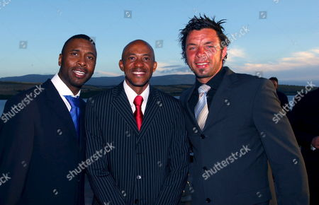 Ex Leeds United Captain Lucas Radebe (l) Olympic Sprinter Frankie Fredericks (c) and Bolton Wanderers Soccer Player Mark Fish (r) Enter the Gala Dinner During the Nelson Mandela Invitational Golf Tournament Presented and Hosted by Gary Player at the Arabella Country Estate Kleinmond South Africa Friday 25 November 2005