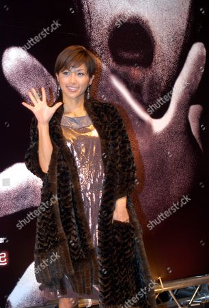 Japanese Actress Noriko Sakai Poses For Photographers During a News Conference in Taipei Tuesday 25 November 2003 to Promote Her New Horror Movie 'Ju On 2'