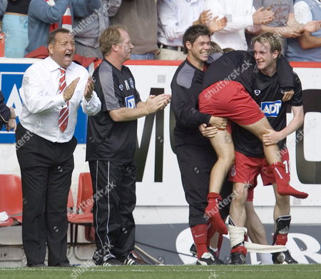 Aberdeen's Bench with Manager Jimmy Calderwood (l) After Defeating Glasgow Rangers During Their Scottish Premier League Football Match in Aberdeen Sunday 14 August 2005 Aberdeen Won 3-2