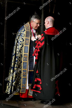 The Very Reverend Dr Wesley Carr Dean of Westminster Abbey Has the Finishing Touches to His Robes Outside Westminster Abbey in Central London Today where He Lead the Memorial Service For Former Conservative Prime Minister Sir Edward Heath Tuesday 8 November 2005