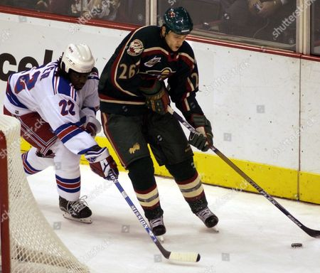 Minnesota Wild Christoph Brandner (r) Fights For Control of the Puck with New York Rangers Anson Carter in the Second Period of Their Nhl Hockey Game at the Excel Energy Center in St Paul Minnesota Friday 10 October 2003