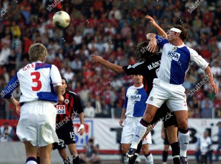 Blackburn Rovers's Lorenzo Amoruso (r) and Vratislav Gresko (no 3) Fights For the Ball with Mustafa Ozkan (2nd Right) of Genclerbirligi During Their Uefa Cup 1st Round 1st Match at 19 May Stadium in Ankara Turkey On Wednesday 24 September 2003 Epa Photo/epa/str// Turkey Ankara