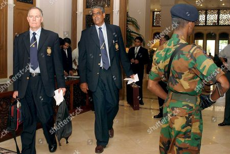 Indian Cricket Coach Greg Chappell (l) and Team Manager (c) Arrive at the Taj Samudra Hotel in While an Armed Special Task Force Policeman Detailed to Provide Security to the Visiting Team Stands by in Colombo Sri Lanka Saturday 23 July 2005 the Indian National Cricket Team is Here to Play in the 'Ioc Cup 2005' a Triangular Test Between Hosts Sri Lanka India and the West Indies Considered One of the Highest Paid Sponsorship in Recent Times This Triangular Was Negotiated by Taj Tv Which Has Secured Television Rights For Sri Lanka Cricket with Indian Oil Company Which Runs Several Fuel Filling Stations in the Island
