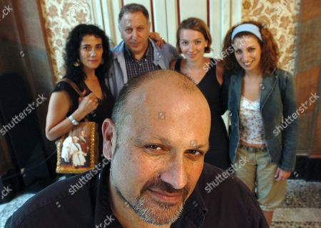 Stock Photo of From From to Back and L-r: Israeli Director Eran Riklis Actress Hiam Abbas Actor Makram Khoury Actresses Julie-anne Roth and Clara Khoury Back From Left to Right Pose After a Press Presentation of Their Film 'Hacala Hasurit' ('the Syrian Bride') at the 57th International Film Festival of Locarno Wednesday 11 August 2004 in Locarno Switzerland Switzerland Schweiz Suisse Locarno