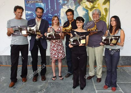(l-r) Palestinian Actor Mohammad Bakri (best Actor) Iranian Director Hassan Yektapanah (silver Leopard) German Actress Maria Kwiatkowsky (best Actress) Italian Director Saverio Costanzo (golden Leopard) German-born Kurdish Director Ayse Polat (silver Leopard) Japanese Director Jun Ichikawa (special Jury Prize) and German Actress Pinar Erincin (best Actress) Pose with Their Awards at the 57th International Film Festival Locarno Saturday August 14 2004 in Locarno Switzerland Schweiz Suisse Locarno