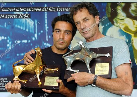 Italian Director Saverio Costanzo Left and Palestinian Actor Mohammad Bakri (r) Pose with the Awards They Received at the 57th International Film Festival Locarno on Saturday 14 August 2004 in Locarno Costanzo Has Been Awarded the Golden Leopard For His Film 'Private' Bakri who Plays a Leading Role in the Same Film Received the Leopard For the Best Actor Switzerland Schweiz Suisse Locarno