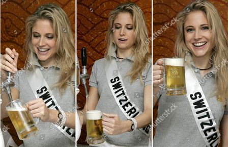 Fiona Hefti Miss Switzerland 2005 Shows Her Own Style of How to Pull a Beer On Tap During a Visit by the 81 Miss Universe 2005 Contestants to the Pathum Thani Brewery Which Makes Singha Beer On the Outskirts of Bangkok Thailand Wednesday 18 May 2005 the Beauty Contestants Were Allowed to Pull Beers On Tap Toast For Pictures But not Drink As Strict Rules Dictate the Girls Public Behaviour a Row Wednesday Over Contestants Wearing Bikinis in Front of Buddhist Sites Broke out Forcing Organisers to Say the Scenes Would Be Edited out of Official Tv Footage the Finals of the 54th Annual Miss Universe Competition Will Take Place in Bangkok Thailand On 31 May 2005
