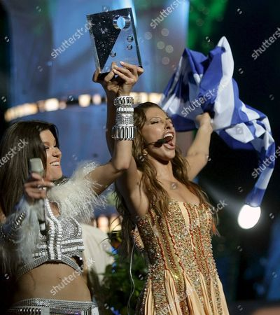 Greek Helena Paparizou (r) Winner of Eurovision Song Contest 2005 Receives the Award From Ukrainian Singer Ruslana (l) Last Years Winner During the Award Ceremony in Kiev Late Saturday Night 21 May 2005 Paparizou Won with the Song 'My Number One'