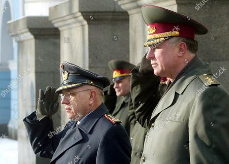 German General Harald Kujat (l) Chairman of Nato Military Committee and Ukrainian Chief of Staff Alexander Zatynayko (r) Salute During Their Meeting in Front of the Defence Ministry in Kiev Ukraine Thursday 12 February 2004 a Nato Delegation Arrived in Kiev On Wednesday For a Three-day Official Visit