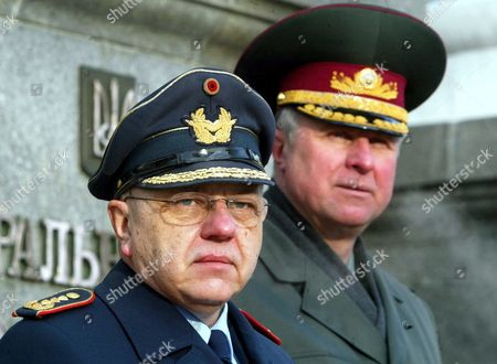 Stock Picture of German General Harald Kujat (l) Chairman of Nato Military Committee and Ukrainian Chief of Staff Alexander Zatynayko (r) During Their Meeting in Front of the Defence Ministry in Kiev Ukraine Thursday 12 February 2004 a Nato Delegation Arrived in Kiev On Wednesday For a Three-day Official Visit