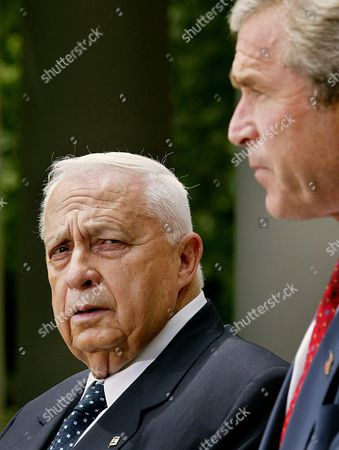 Israeli Prime Minister Ariel Sharon (l) Listens to Us President George W Bush During Their Brief Statements in the Rose Garden at the White House in Washington Dc Tuesday 29 July 2003 Earlier Sharon and Bush Met in the Oval Office to Discuss the Middle East Peace Process Epa Photo/epa/shawn Thew United States Washington