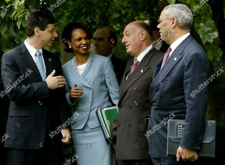 Us National Security Advisor Condoleezza Rice (2nd L) with Us Secretary of State Colin Powell (r) Chat with Israeli Ambassador to the Us Danny Iyalon (l) and Israeli Chief of Staff Dov Weisglass (2nd R) in the Rose Garden at the White House in Washington Dc 29 July 2003 the Officials Were Waiting For Us President George W Bush and Israeli Prime Minister Ariel Sharon to Emege From the Oval Office After a Meeting Epa Photo/epa/shawn Thew United States Washington